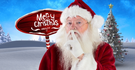 Digital composite of Merry Christmas text and Santa hushing quietness with Wooden signpost in Christmas Winter landscape
