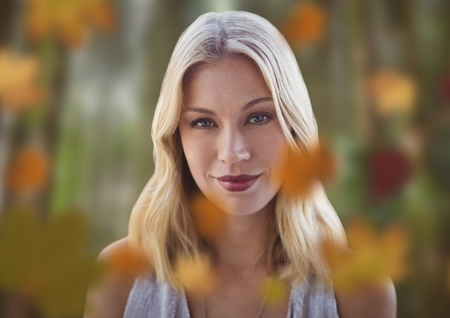 Digital composite of Womans face in forest with leaves Stock Photo