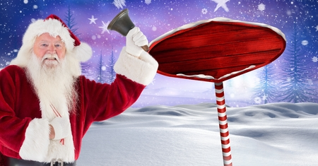 Digital composite of Santa holding a bell and Wooden signpost in Christmas Winter landscape