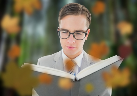 Digital composite of Man in forest with leaves