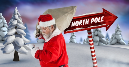 man looking out: Digital composite of North Pole text and Santa holding sack with Wooden signpost in Christmas Winter landscape Stock Photo