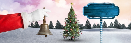Digital composite of Santa holding bell and Wooden signpost in Christmas Winter landscape with Christmas tree Banco de Imagens - 89201747