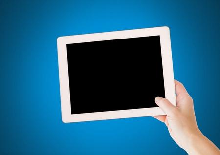 Digital composite of Hand holding tablet with blue background Reklamní fotografie