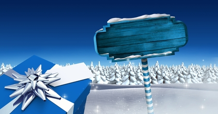 Digital composite of GIft and Wooden signpost in Christmas Winter landscape