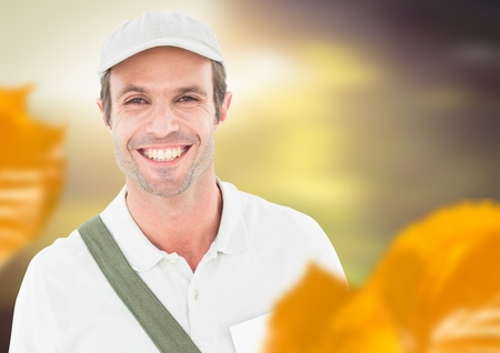Digital composite of Man wearing cap in forest with leaves Stock Photo