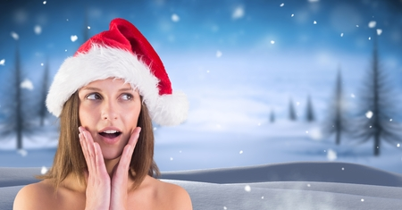 Digital composite of Amazed female Santa in Christmas Winter landscape