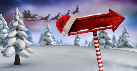 lush foliage: Digital composite of Wooden signpost in Christmas Winter landscape and Santas sleigh and reindeers