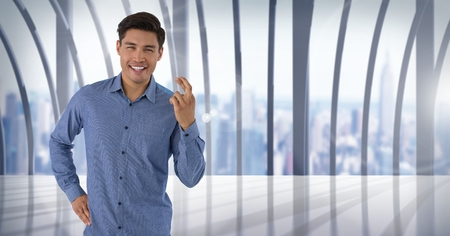 Digital composite of Businessman crossing fingers in city office