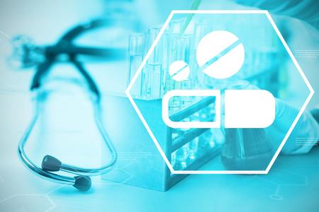 Digital background with medication sign  against stethoscope on desk