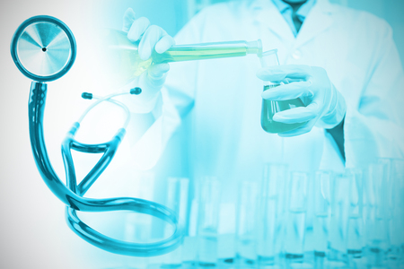 Blue stethoscope  against scientist making chemical
