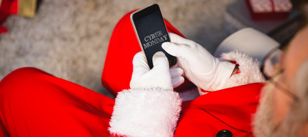 domicile: Title for celebration of cyber Monday  against santa claus using mobile phone at home Stock Photo