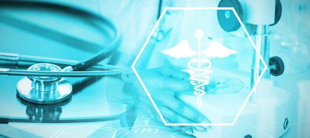 Background with medical sign  against stethoscope on digital tablet Stock Photo