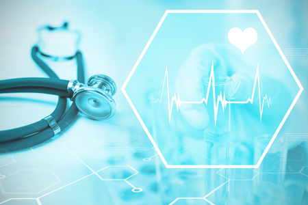 Digital background with heart movement sign  against stethoscope on desk Stock Photo
