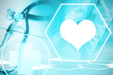 Digital background with heart sign  against stethoscope on desk Stock Photo