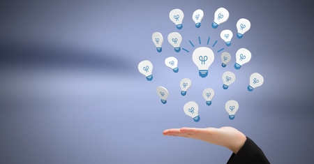 Digital composite of Hand open with 3D light bulb idea icons