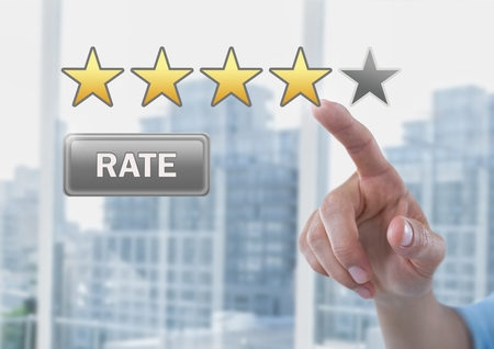 Digital composite of Hand pointing at Rate button and star reviews in city office Reklamní fotografie