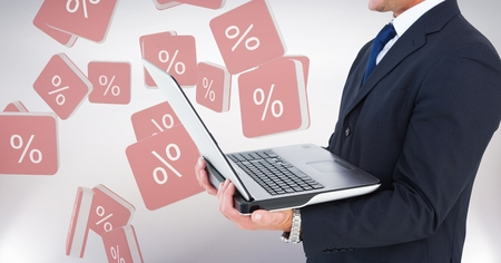 Digital composite of Hand holding laptop with percent symbol icons background