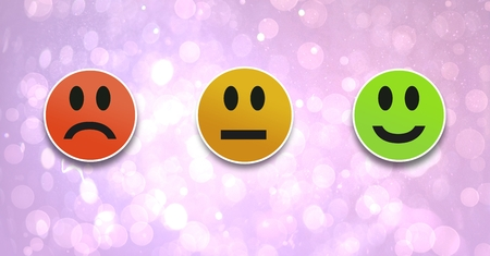 Digital composite of smiley faces feedback satisfaction icons on bokeh background
