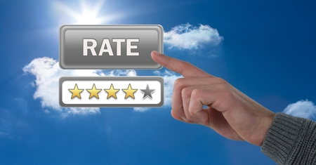 Digital composite of Hand touching rate button and review stars