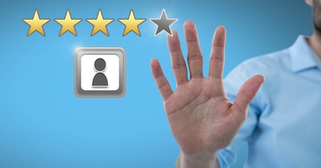 Digital composite of Hand touching review rating stars Reklamní fotografie - 96543537