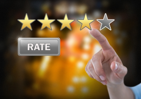 Digital composite of Hand touching review stars and rate button