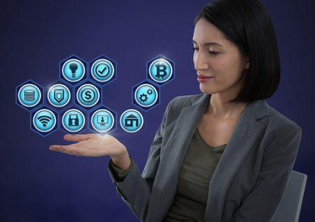 Digital composite of Businesswoman with hands palm open and various business icons