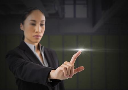 Digital composite of Businesswoman touching air glow Archivio Fotografico - 97227045