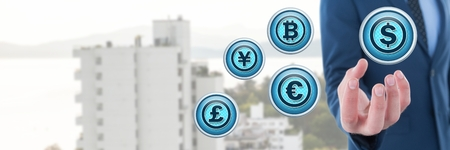 Digital composite of currency icons and businessman with hand palm open in city