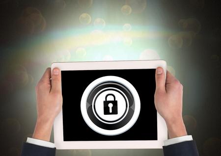 Digital composite of tablet in hands and security lock icon Banco de Imagens