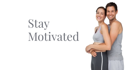 Digital composite of Stay motivated text and fitness couple Stock Photo