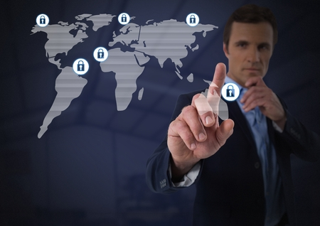 Digital composite of Businessman touching security lock icons on map
