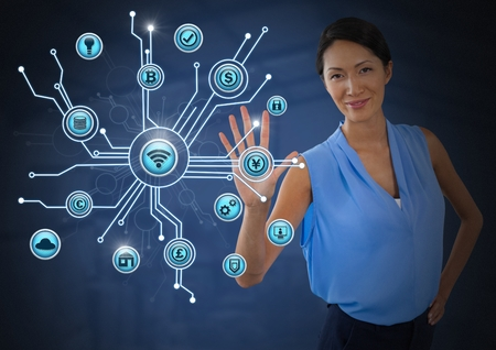 Digital composite of Businesswoman touching various business icons interface Stock Photo