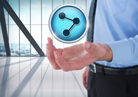 Digital composite of Connect icon and Businessman with hand palm open in city office Фото со стока