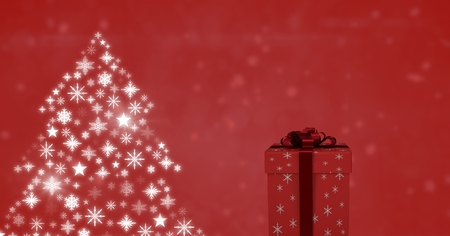 Digital composite of Gift box and Snowflake Christmas tree pattern shapes Stock Photo