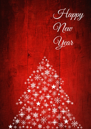 Digital composite of Happy New Year text and Snowflake Christmas tree pattern on wood Stock Photo