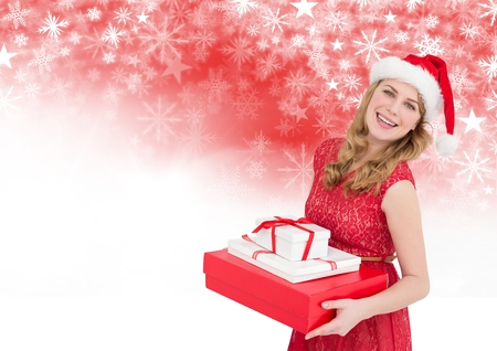 Digital composite of Woman holding gifts and Snowflake Christmas pattern and blank space