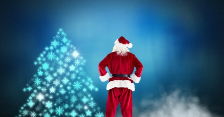 Digital composite of Santa looking at snowflake Christmas tree pattern shape Stock Photo