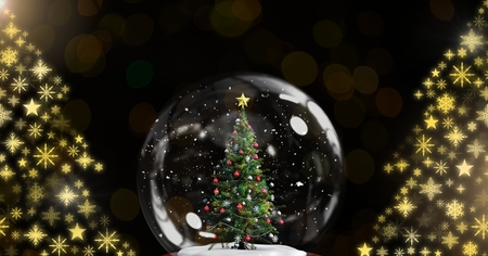 Digital composite of Christmas tree snow globe and Snowflake Christmas tree pattern shapes