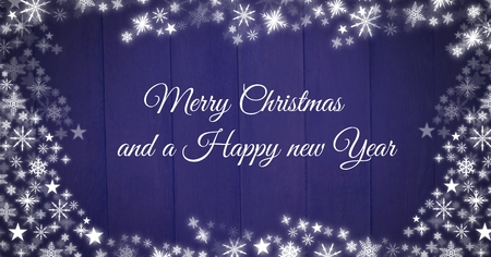 Digital composite of Merry Christmas and a Happy New Year text and Snowflake Christmas patterns on wood