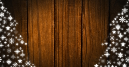 Digital composite of Snowflake Christmas patterns on wood