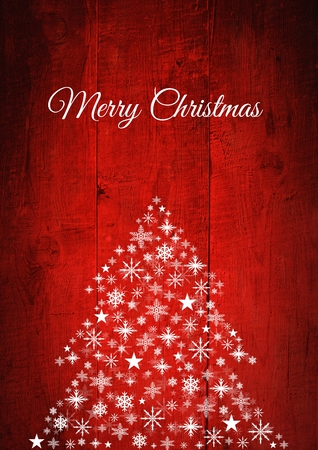 Digital composite of Merry Christmas text and Snowflake Christmas tree pattern on wood Stock Photo