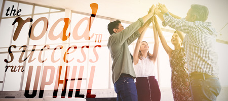 The road to success run uphill against business people raising hands at office Stock Photo