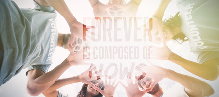 Friends putting their hands together against forever is composed of nows  Stock Photo