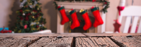 Rusty wooden plank against fireplace decorate with christmas decor and ornaments Stock Photo