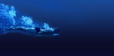 Man swimming in deep blue water Stock Photo