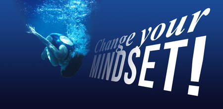 Change your mindset message on a white background against man swimming in blue water Stock Photo