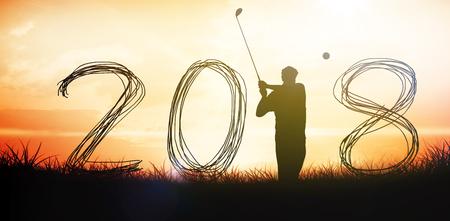 Golfer playing  against orange sunrise Stock Photo
