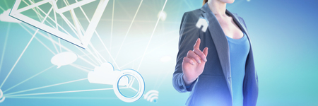 Mid section of businesswoman using imaginary interface against abstract green background,
