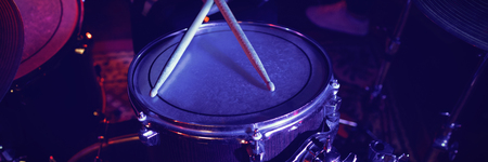 Mid section of drummer performing at concert in nightclub 스톡 콘텐츠