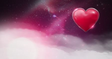 Digital composite of Shiny heart glowing with purple space universe misty background Stock Photo